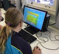 Year 6 student engaging with ABCya animate workshop run by Year 9 Mossman State High students